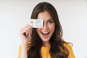 Happy woman with her credit card