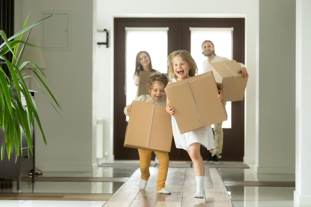 Happy family moving to their new rental home